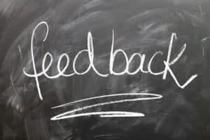 Feedback written on blackboard, asking for reviews